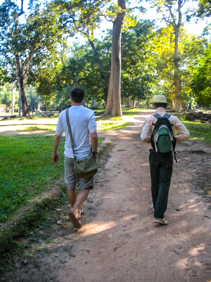 Walking through Angkor Archaeological Park with our guide.