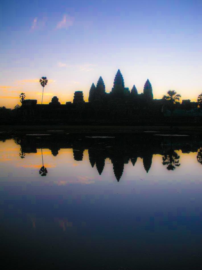 Angkor Wat illuminated at sunrise.