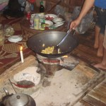 Thai Food: Cooking curry in a bamboo hut on top of a mountain