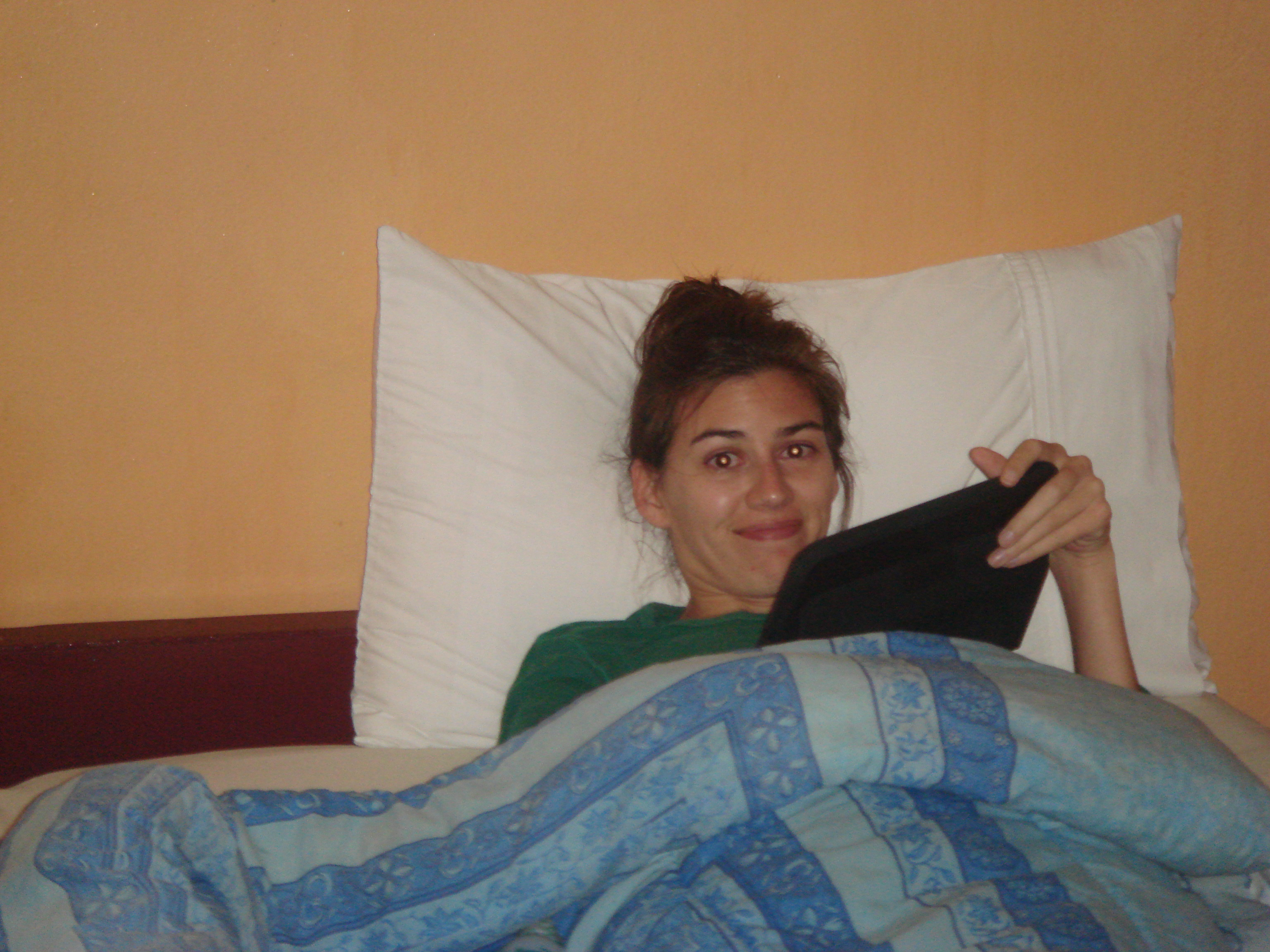 Using my Tablet travel electronic in bed in Chiang Mai.