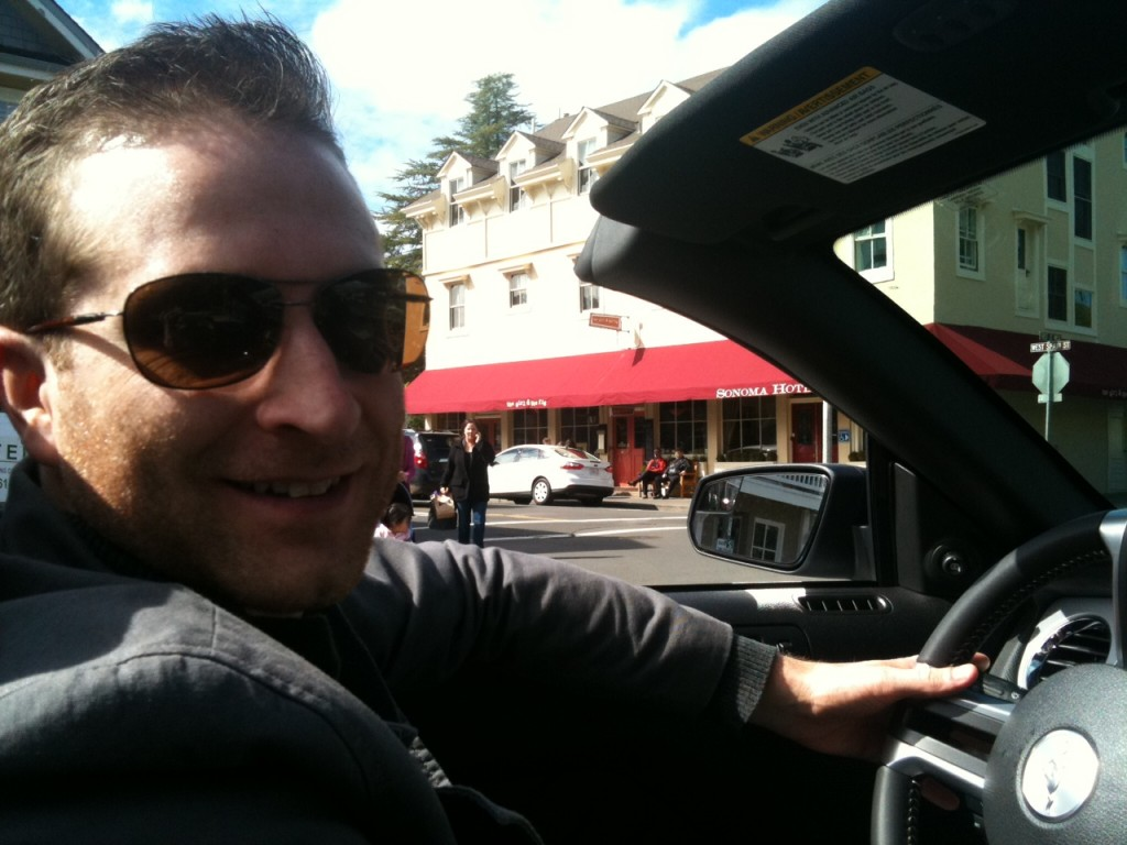Tom driving in front of The Girl and the Fig Restaurant in Sonoma, California