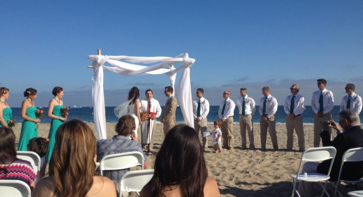Exchanging vows right on the sand in Santa Barbara - my dream mini-destination wedding