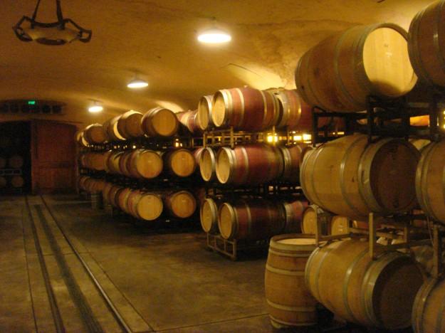 Stacks of wine barrels housing some of Napa's exquisite wine.