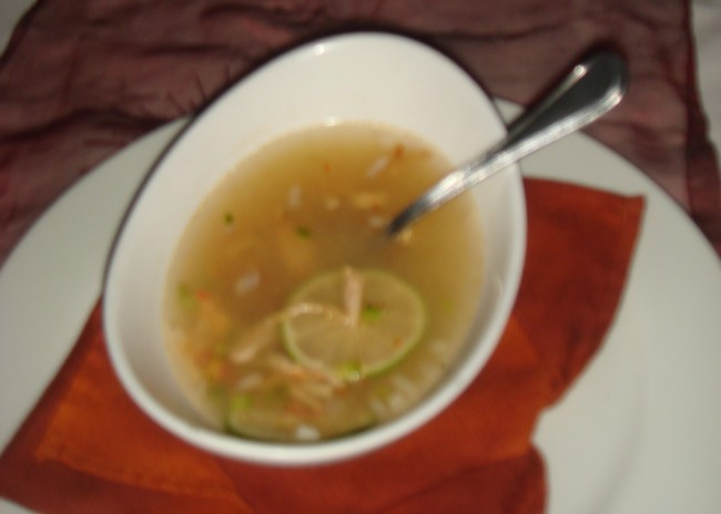 The soup at Alux restaurant was amazing. This one came with tortillas, salsa, and limes in the bowl. Then the server poured the broth over it at the table. It was delicious! (And was not blurry in real life.)