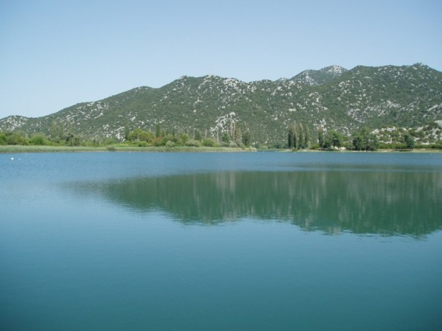 Calm, mirror-lake waters of Bacina Lakes.