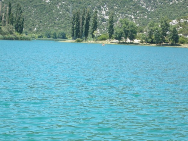 The water of Bacina Lakes is a bright blue, nearly turquoise in parts.