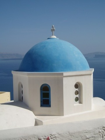 The blue dome of a church in Santorini, Greece.