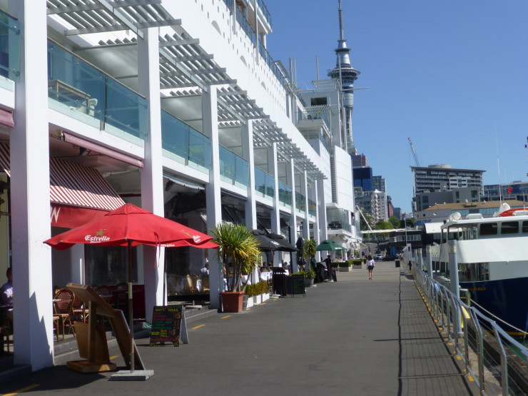 Auckland: Leaving the lovely little harbor restaurants to head to the Sky Tower, seen in the distance.