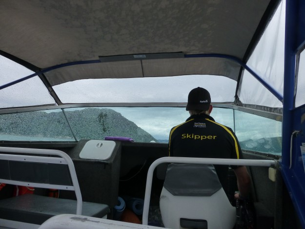 Our nice taxi driver navigating us through the rocky seas.