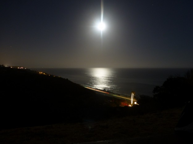 The super moon in a black sky as night descended upon Malibu.