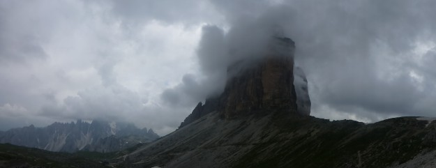 Clouds magnificently wrapping around the Tre Cime peaks.
