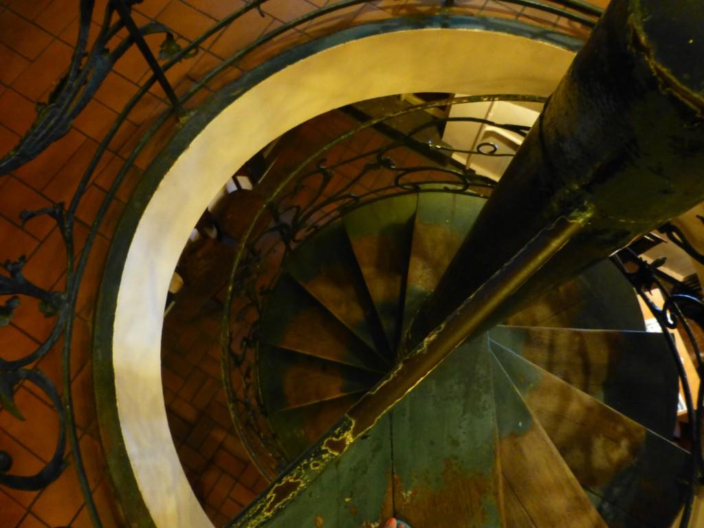 Looking down on the green spiral staircase at Zur Letzten Instanz Restaurant in Berlin.