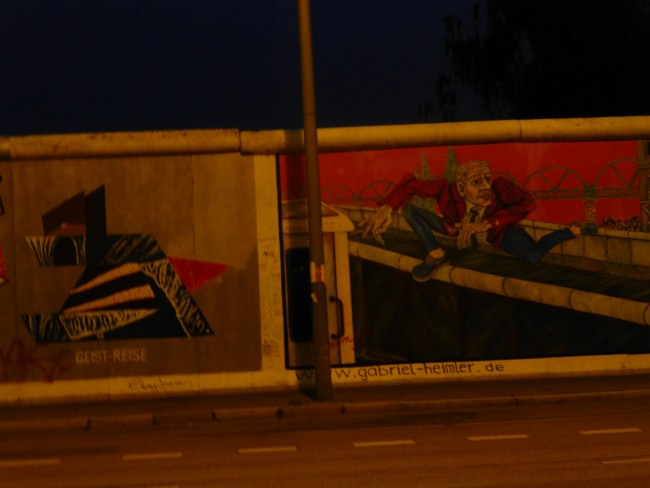 Drive by shot of the East Side Gallery in Berlin.