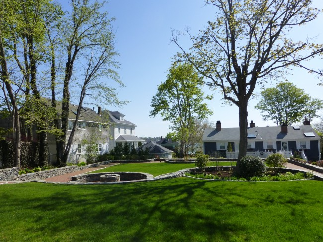 The large yard with a fire pit at Cliffside Inn.