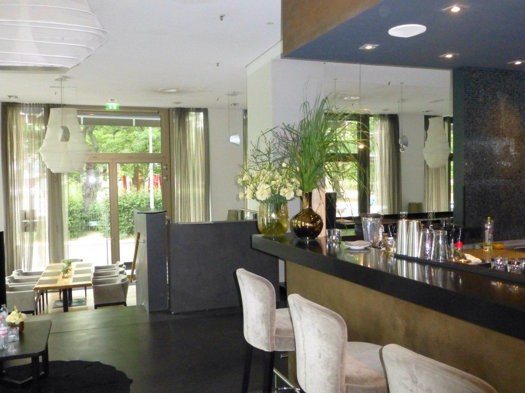 Bar and dining room beyond it at Scent Restaurant in Cosmo Hotel.