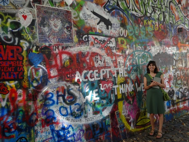 Perusing the artwork at the Lennon Wall in Prague.