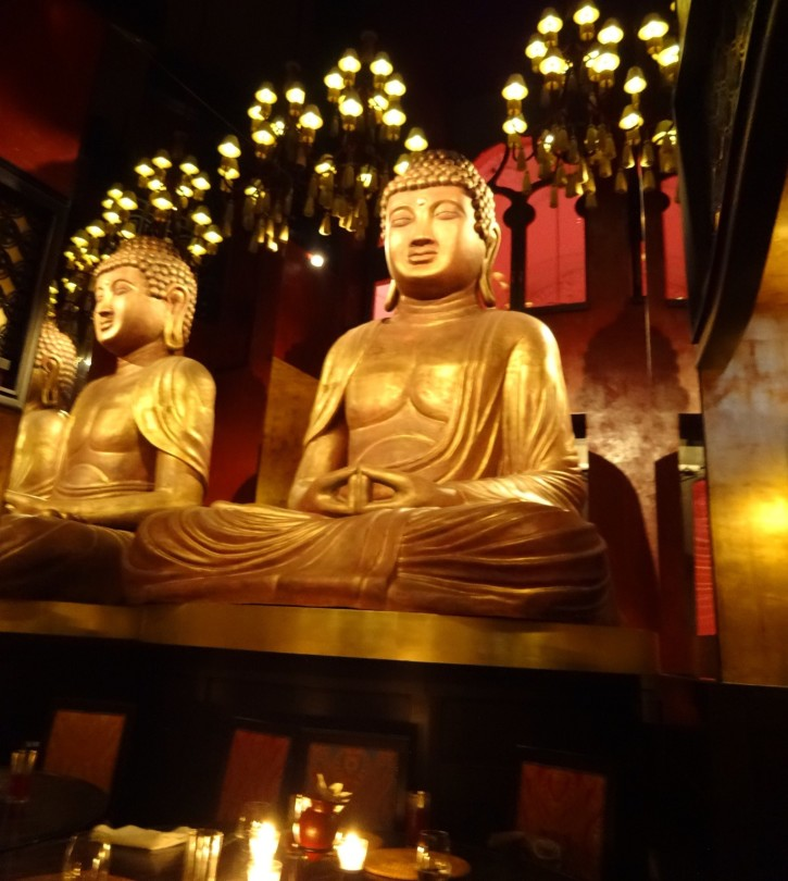 Buddha Statue with Mirror Reflections in Buddha-Bar Restaurant