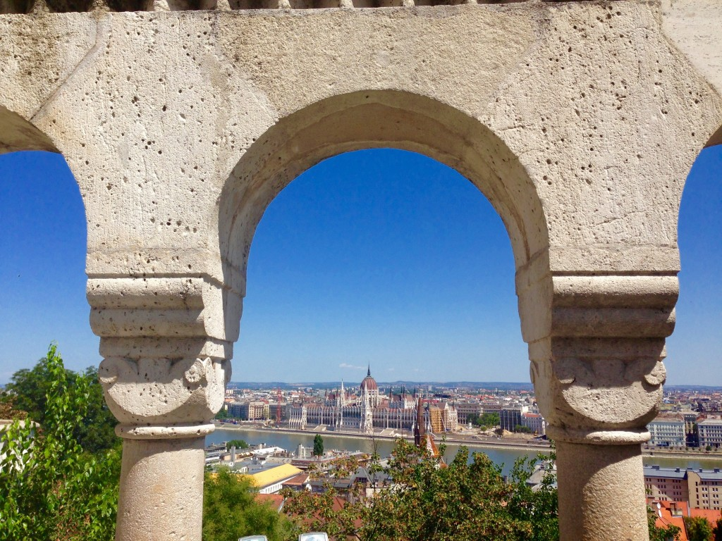 Take a day trip from Vienna to the gorgeous city of Budapest, Hungary, seen here from Fisherman's Bastion overlooking the Danube River and Parliament building.