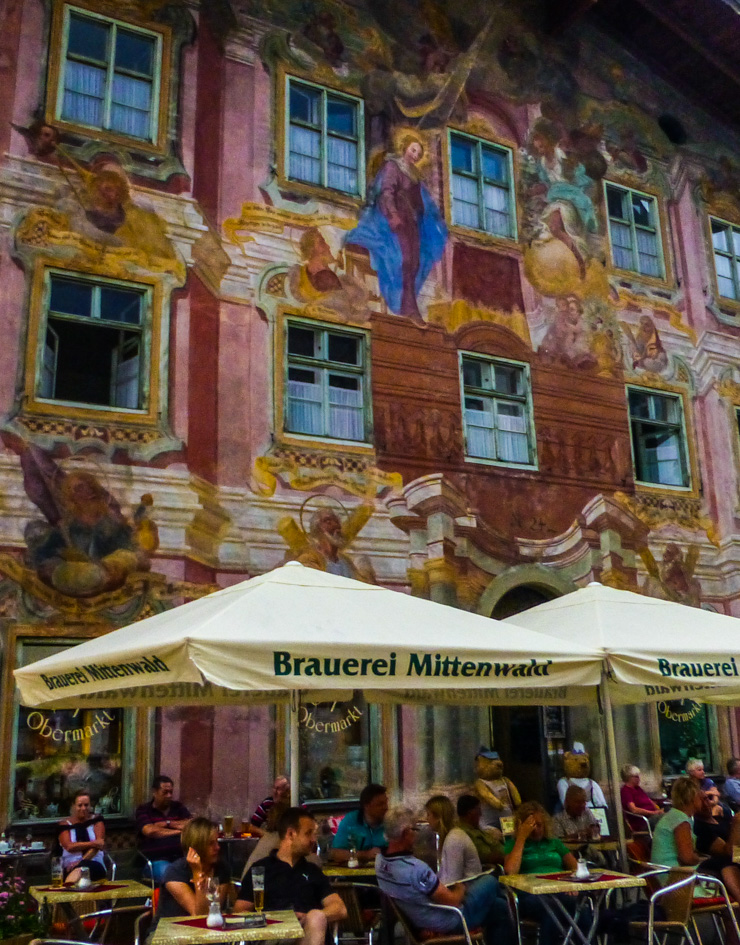 Dine right underneath an elaborately decorated frescoed building in Mittenwald, Germany.