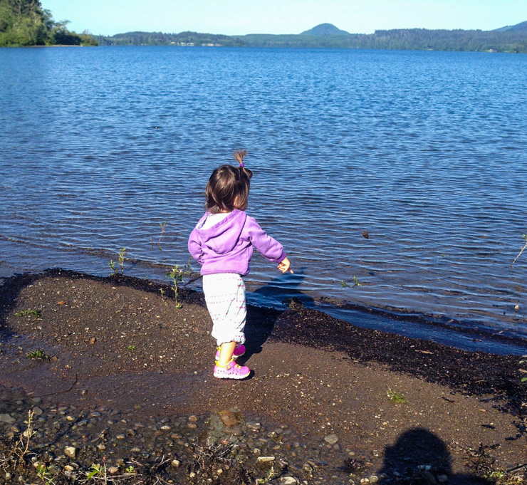 Throwing rocks in Lake Quinault.