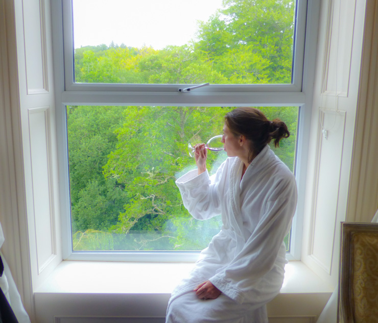 Enjoying that gorgeous Killarney view in the cozy bathrobe the hotel provides.