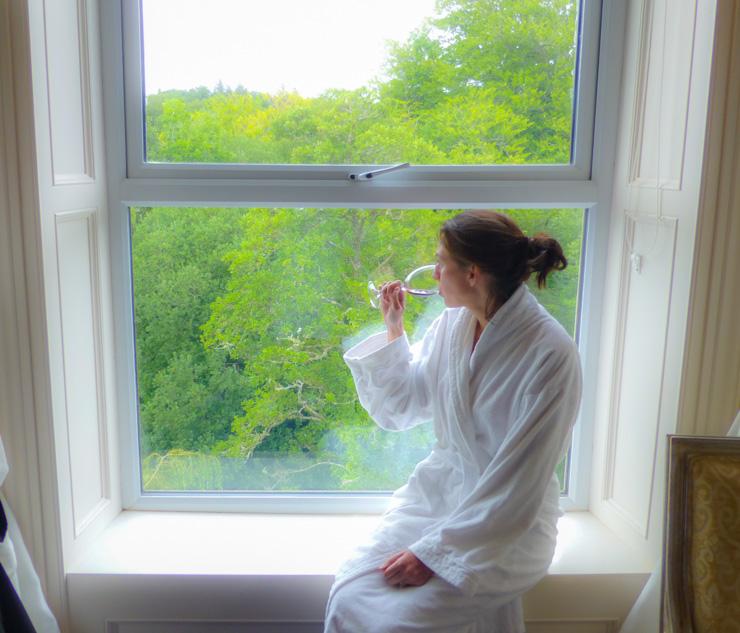 Enjoying that gorgeous Killarney view in the cozy bathrobe the hotel provides.