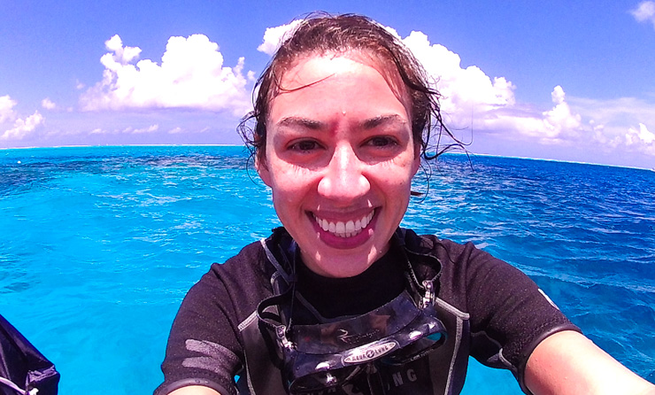 Me with a big smile after scuba diving in Bora Bora and seeing my first shark!