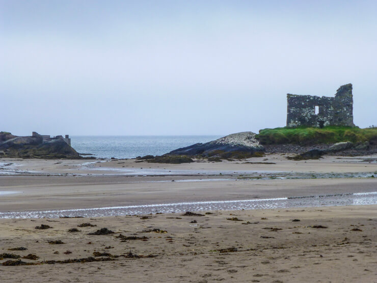 Ballinskelligs Castle and Beach: a must-see sight along the Ring of Kerry in Ireland.