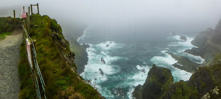 Rugged and rough waves on a cloudy day at Kerry's Most Spectacular Cliffs along the Ring of Kerry.