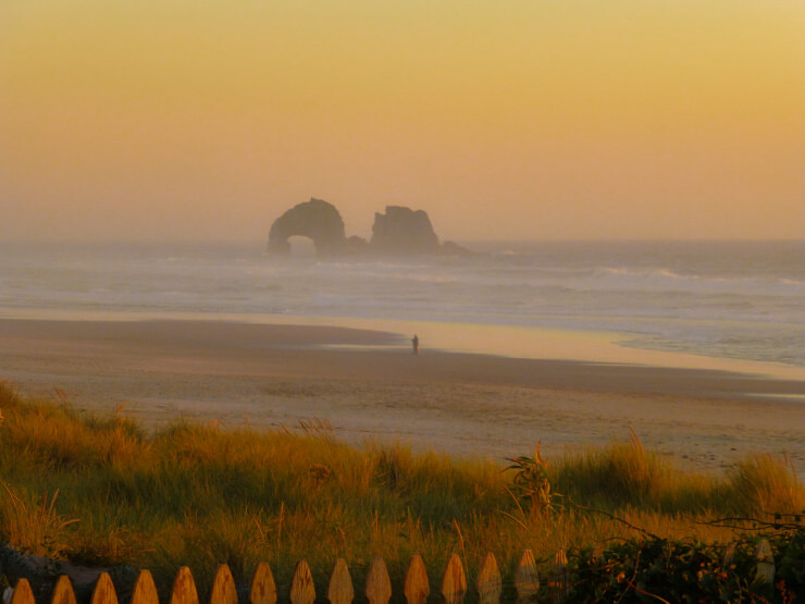 The wide beach and large rock structures of Rockaway Beach, Oregon