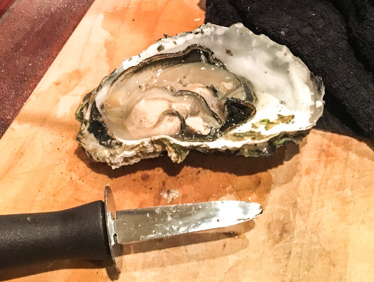 Trying an oyster is one of the top things to do in Rockaway Beach Oregon -- just make sure you have an oyster knife if you plan on doing it yourself.