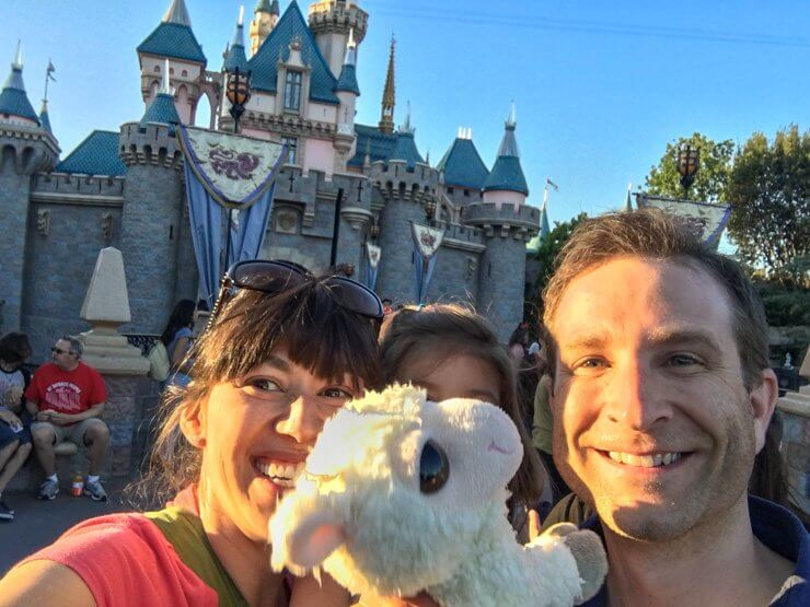 Family selfie time in front of Sleeping Beauty Castle at Disneyland