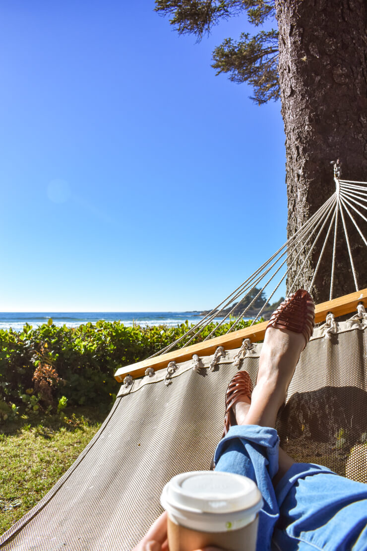 Relaxing in a hammock on the grounds of Pacific Sands Resort in Tofino