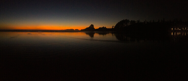 Panoramic shot of a sunset in Tofino on Cox Beach Bay