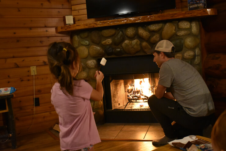 Roasting marshmallow in our adorable cabin at Tigh-na-mara Resort
