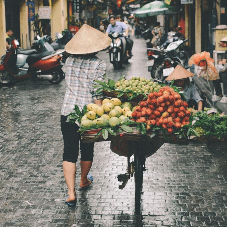 Pedestrian walking down a street in Hanoi.