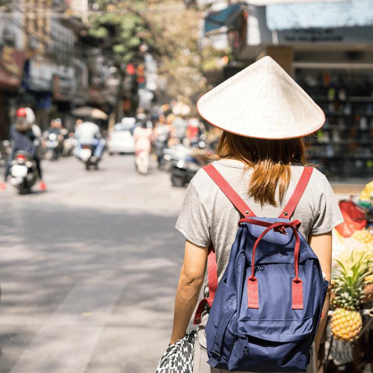 Traveler in Hanoi Old Quarter