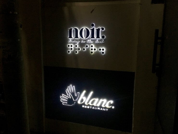 Welcome signs for Noir and Blanc Restaurants in Ho Chi Minh City, unique dining experiences that include eating in the dark or ordering using sign language.