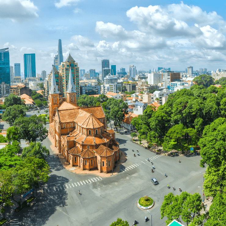 Ho Chi Minh City's Notre Dame Cathedral framed by the city skyline.