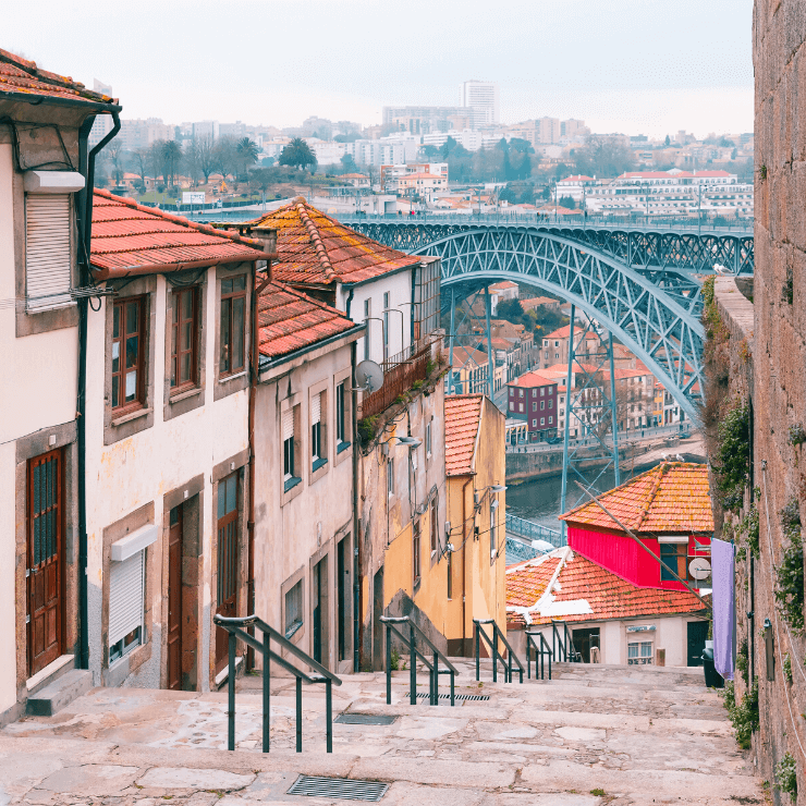 Pretty cobblestoned street in the Ribeira District of Porto overlooking the water.
