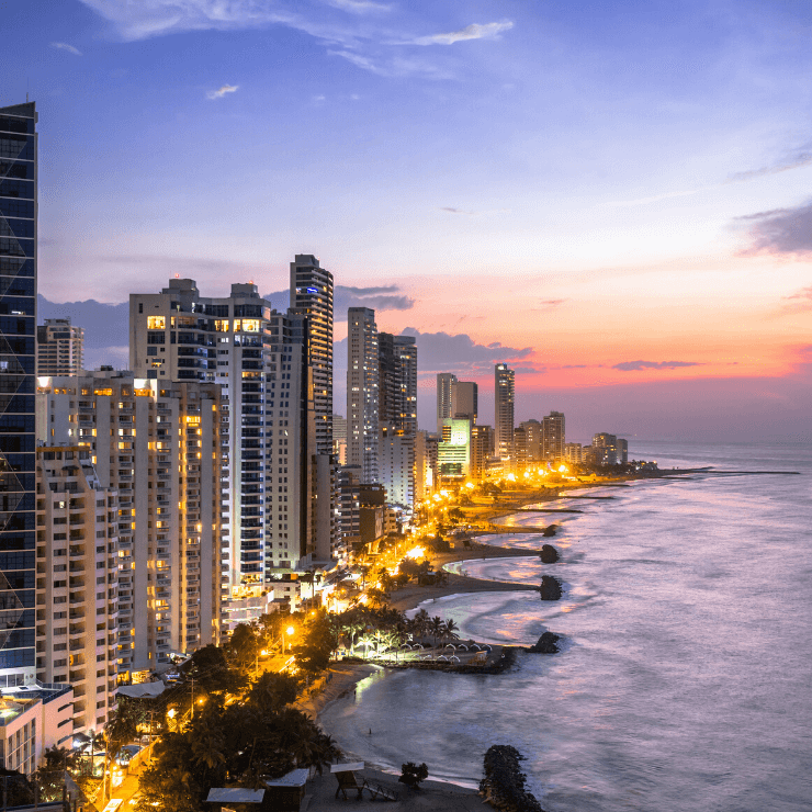 Sunset behind the skyscrapers of Cartagena, Colombia with an ocean view.