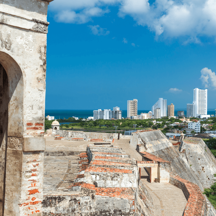 Castillo San Felipe with view of Cartagena's skyscrapers. The Castillo San Felipe is a must-visit even if you have just one day in Cartagena.