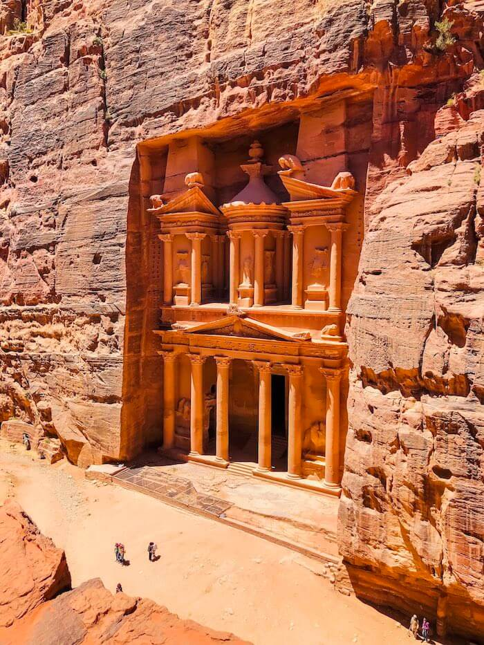 The treasury in Petra seen from an elevated viewpoint.
