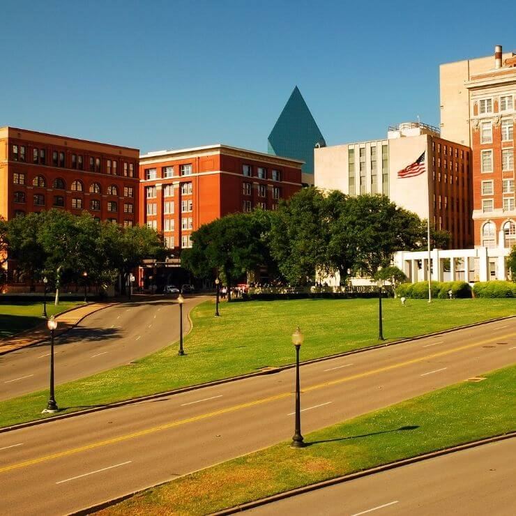A 24-hour itinerary in Dallas must include a visit to Dealey Plaza and the Grassy Knolls.