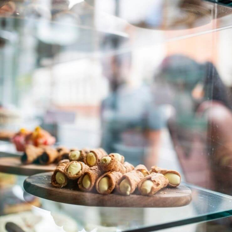 Yummy pastries seen through a window of a London Bakery.