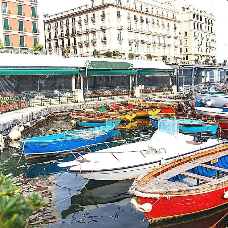 The pretty harbor of Borgo Marinari is great for boat and people watching