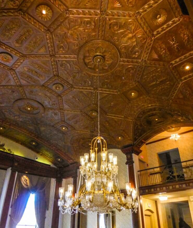 Beautiful, historic ceiling and chandelier in Providence's the Biltmore Hotel, a great place to stay during a Providence getaway.