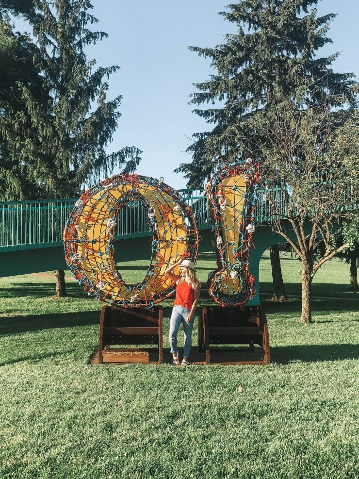 Sculpture in Omaha, Nebraska of a colorful O with an exclamation mark.