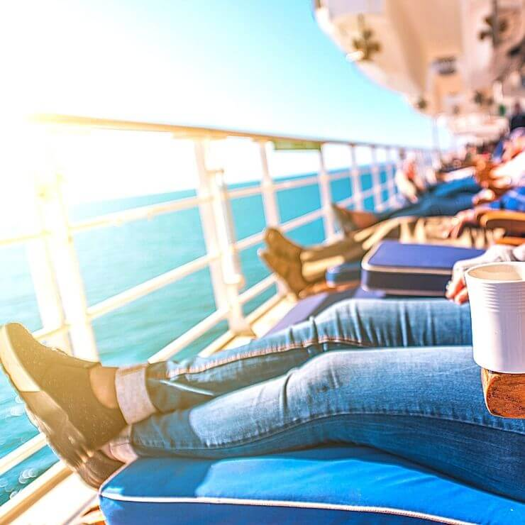 Group of travelers relaxing on a cruise ship terrace.