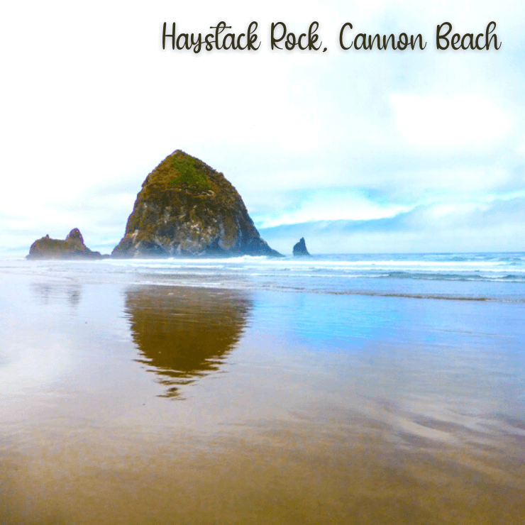 Iconic Haystack Rock on Cannon Beach, one of the best girls getaways in the Pacific Northwest